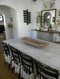 Love the light grey washed table with the black chairs