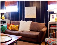 Paint a section of a wall and use vertical stripes in areas to give separation for other parts of the office and emphasize height in the room.