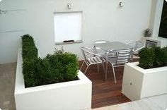Small deck area - defined by planters