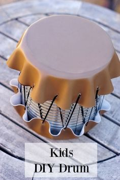 Upcycle a large can into a drum for kids! A perfect activity for kids on Spring or Summer Break.