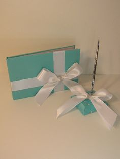 I know it's so over done but I still love Tiffany wedding theme :)    Tiffany Blue Wedding Guest Book and pen holder
