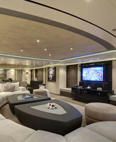 Here is a stunning living room -- on a yacht! The TV is on a lift so it can be lowered and kept safe during rough waters, but brought out again, in a stunning way, when everyone's ready to watch.