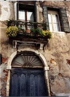door, window and flower box display on grand canal in venice