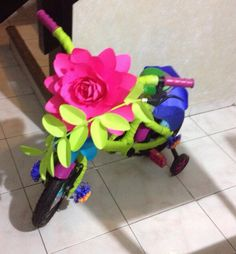 Could see this done with large silk rose and greenery from Hobby Lobby or make paper or tissue flowers. Bike Parade, Pet Parade, Tissue Flowers, Giant Paper Flowers, Diy For Kids, Crafts For Kids, Bike Decorations, Bicycle Decor, Silk Roses