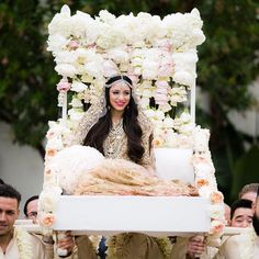 This regal palanquin is dripping with lush pink and white peonies and garden roses. Indian Wedding Pictures, Indian Wedding Poses, Indian Wedding Photography, Indian Weddings, Photography Ideas, Photography Gallery, Real Weddings, Bride Entry, Wedding Entrance