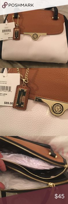 Anne Klein Lady Lock Bag This bag does have a removable shoulder strap. I 1 x 8-1/2 x 4. Anne Klein Bags Shoulder Bags