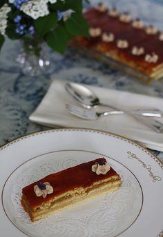 Thin layers of almond butter cake, rich Austrian espresso buttercream ...