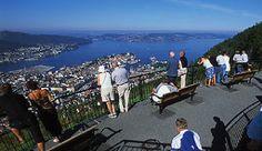 People enjoying the view over Bergen from the Fløien Mountain, Norway - Photo: Terje Rakke/Nordic Life/Fjord Norway