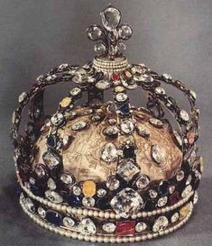 The coronation crown of Louis XV. It was originally set with the Regent and Sancy Diamonds, the Sancy being the larger stone at the top of the crown in the fleur-de-lis. The Regent is in the circlet on the front of the crown. Www.ambragold.com
