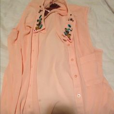 Beautiful light orange button down gem shirt This is very pretty has a bunch of gems at the top very colorful gems a button down tank top has a pocket in the front of the shirt Moon Collection Tops Button Down Shirts