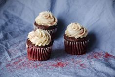 Red velvet cupcakes against a bedsheet with natural window light. #foodphotography #cupcakes #redvelvet