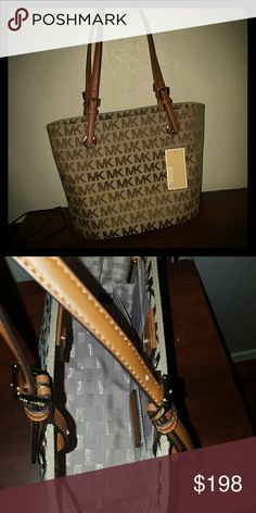 Michael Kors Medium Tote Signature MK logo on tan and bag tote. Can be paired with any outfit Michael Kors Bags Shoulder Bags