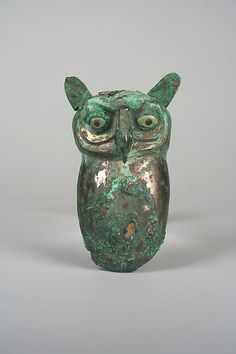 Owl , Moche culture, Peru. 390-450AD . silvered copper, shell and pyrites.