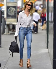Pretty as a picture: The supermodel teamed the tight denim with a delicate white blouse - June 8, 2016