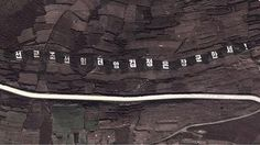 Satellite photo of the slogan taken 06/10/12