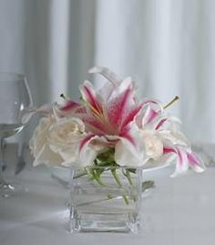Stargazer Lily & White Rose Centerpiece....the lillies would have significance for me :) Stargazer Lily Wedding, Rose Wedding, Wedding Flowers, Dream Wedding, Stargazer Lilies, White Rose Centerpieces, Wedding Centerpieces, Wedding Decorations, Centerpiece Ideas