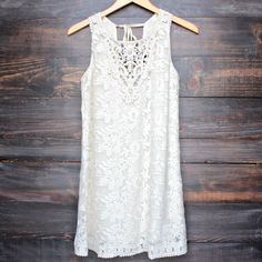 fully lined crochet hem detailing throughout tie back sleeveless imported