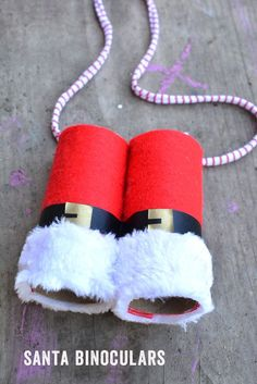 DIY Santa Binoculars - fun Christmas craft for kids. Part of the SeeHearTouchTasteSmell Christmas Sensory Play Series of kids' Christmas Activities