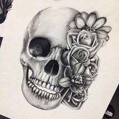 Skull with flowers tattoo idea sketch