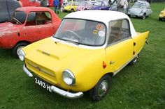 Anyone care to identify this funky little microcar for me?