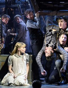 """The story of """"Peter and the Starcatcher"""" is improbable enough – a sprawling adventure involving orphans and pirates, mermaids and deadly mollusks that has landed on Broadway with inventive use of ropes instead of video projections or hydraulic lifts. But the transfer of this deliberately low-tech charmer from the main stage of the New York Theatre Workshop (with its 198 seats) to the Brooks Atkinson on Broadway (with its 1,069 seats) achieves the near-impossible: It actually has gotten…"""