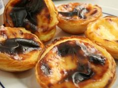Pastel de nata (Portuguese sweet egg custard tarts) - couple of these with a strong coffee, sat in the sun outside a little cafe in rural Portugal... bliss :)