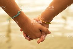 Close up of two children holding hands on the beach sand, summertime. Friends Holding Hands, Children Holding Hands, Hold Hands, Making Friendship Bracelets, Bracelet Making, Buy Essential Oils, Rainy Day Fun, Doterra Oils, Happy Kids
