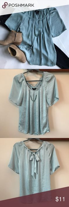 """Turquoise Blue Blouse Feminine turquoise blue 100% polyester blouse with soft pleated front and adjustable tie neckline in back.    • Size M        • 27"""" Length        • 22"""" across bust line Spence Tops Blouses"""