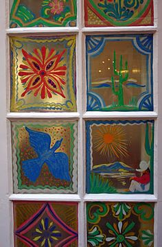 La Fonda Hotel, Santa Fe, NM...All the original and signature hand-painted windows are intact and surround the dining room, adding a lovely folk-charm to the room.  Photography by Chasing Santa Fe.