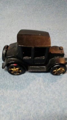 Check out this item in my Etsy shop https://www.etsy.com/listing/488314219/vintage-cast-iron-toy-model-t-car