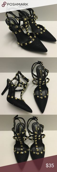 """BCBG Strappy Studded Heels BCBGeneration   Style: Darronx-x   With strappy styling and gold stud accents, these are some damn sexy shoes! Pointed toe pump, double t-strap with adjustable buckles, 3½"""" covered heel. Worn once, excellent condition. Original box available. BCBGeneration Shoes Heels"""