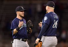 Shawn O'Malley #36 an dAdam Lind #26 of the Seattle Mariners celebrate winning the game against the Minnesota Twins on September 23, 2016 at Target Field in Minneapolis, Minnesota. The Mariners defeated the Twins 10-1.