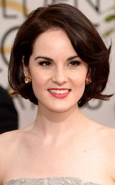 Michelle Dockery from Beauty Police: 2014 Golden Globes Lady Mary can do no wrong in our book. That shiny, perfectly-coiffed hair, the alabaster skin and subtly lined eyes, topped off with a pinky coral lip equals pure perfection.