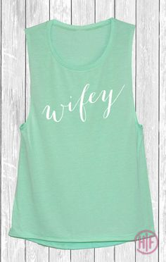 Beautiful active wear Muscle tank with the quote: wifey is light and airy perfect for working out. These Muscle tanks are perfect for anyone