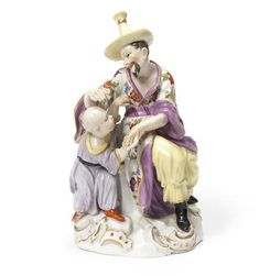A Meissen Chinoiserie group of a man and child, circa 1750