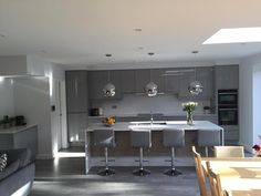 A contemporary grey gloss kitchen shown in silver grey finish. Grey Kitchen Diner, Grey Gloss Kitchen, Modern Grey Kitchen, Kitchen Diner Extension, Open Plan Kitchen Diner, Grey Kitchen Designs, Kitchen Room Design, Kitchen Family Rooms, Modern Kitchen Design