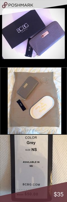 BCBG Wallet Grey wallet by BCBG Paris. NWT and never used! Measurements: 7.5 x 4 in. Plenty of space for cards, cash, and change! Excellent Condition! Let me know if you have any questions! ✅ I LOVE OFFERS ✅ 💜INSTAGRAM: @ocaputostyle BCBG Bags Wallets