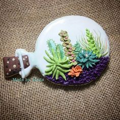 I added some hand painted succulents into my terrarium cookie. I think it looks better#succulents #succulentcookies #terrarium #terrariumcookie #handpainted #cookies #sugarcookies #cookieart #sugarart #edibleart #icing #royalicing #royalicingcookies #cookiesofinstagram #instagram #sydneycookies #cookielove #customcookies #customdecoratedcookies #decoratedcookies #decoratedsugarcookies #royalicingcookiersaustralia #innerwest #innerwestsydney #homemade #homemadecookies #madeinsydney #madewi...