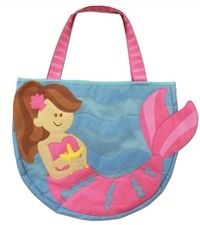 Every little girl wants her own tote bag for the beach, complete with two spades and three beach-themed moulds.