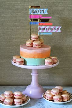 Delicious looking macaron cake with Meri Meri flags! available from www.larkstore.com.au