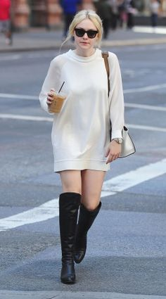 Vogue Daily — Dakota Fanning in white jumper dress and high black boots #celebrities #fashion