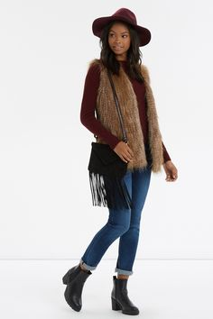 Your boho side deserves this cosy faux fur gilet.