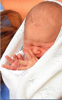 New born Prince Cambridge's royal wave as his parents present him to the public.  How sweet!  <3