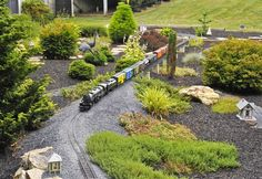 Glen Stegmiller has loved model trains since he was a boy and was so passionate about his hobby that eight years ago he opened a model train store, The Moose Caboose, in Sykesville/Winfield. Formal Gardens, Small Gardens, Garden Railings, Escala Ho, Garden Railroad, Train Pictures, Love Garden, Model Train Layouts, Fairy Houses