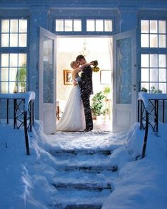 Lovely snowy winter wedding photo without having to actually go out in the snow (not the couple at least) l http://MyWedding.com
