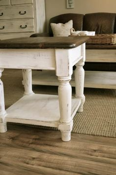 Distressed off white and brown coffee table and 1 End tableSolid wood. Just refinished, great farmhouse lookGreat farmhouse/rustic look.Coffee table Dimensions: table Dimensions: Price is for the set of 2 Decor, Rustic Vintage Decor, Distressed End Tables, Table, Coffee Table Farmhouse, Home Decor, End Tables, Trending Decor, Coffee Table