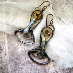 The Ancients, carved stone hands, wire eyes, fossil sea lily stem earrings by Anvil Artifacts