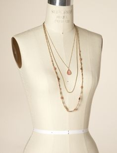 Long, layered necklaces...even better. Way to dress up a tee, skinny jeans, and some flats.