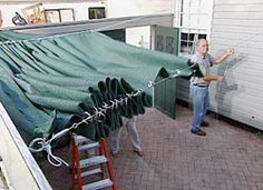 Learn how to make and install a retractable shade screen; includes details on working with shade screen, grommets, and wire cable. Deck Shade, Pergola Shade, Pergola Canopy, Outdoor Shade, Tarp Shade, Garden Shade, Shade Sails, White Pergola, Shade Canopy