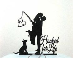 """This Personalized Wedding Cake topper is beautiful Bride and Groom silhouette with fishing rod caught your heart!  Add your initials in the heart.  Size; 5W x6H  Topper is lightweight so it will not sink into your cake, yet sturdy, the perfect combination. It has a stake at the bottom so that it can be placed securely into the cake, the stake measure approx 1.75, the sticks are non removable.  It's made of 1/8"""" Black ABS plastic with non reflecting pebbled surface on the front and smooth..."""